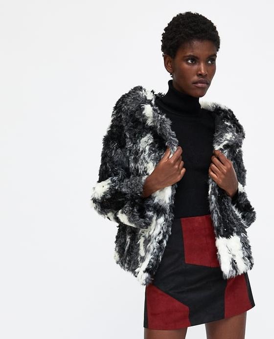 manteau fausse fourrure court noir blanc