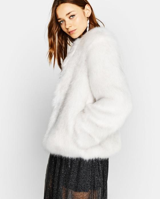 manteau fausse fourrure court blanc